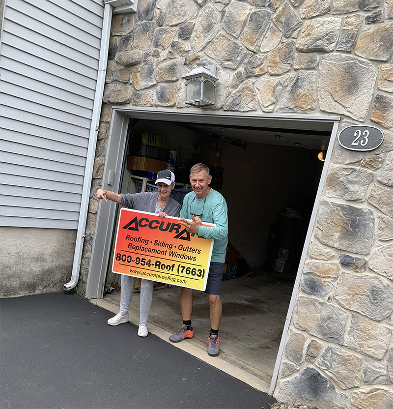 Satisfied Newtown PA customer holding Accurate sign